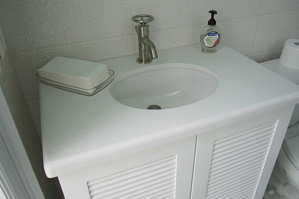 White Quartz Bathroom Counter bathroom countertops - liberty home solutions, llc